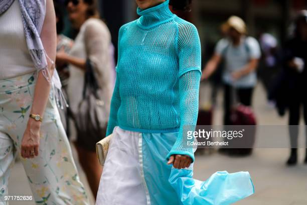 A guest wears a blue lace mesh top during London Fashion Week Men's June 2018 on June 10 2018 in London England