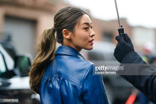 Guest wears a blue leather jacket, outside Coach, during New York Fashion Week Fall Winter 2020, on February 11, 2020 in New York City.