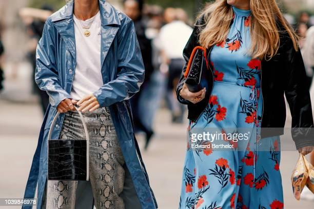 A guest wears a blue pvc coat a black crocodile leather bag snake print pants a guest wears a blue floral print dress during London Fashion Week...