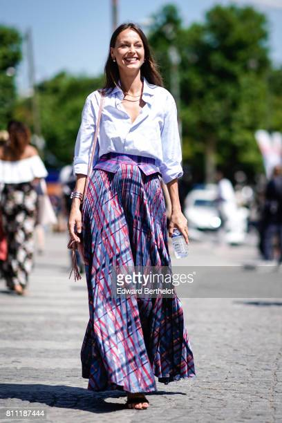 A guest wears a blue shirt a purple ruffle dress outside the Chanel show during Paris Fashion Week Haute Couture Fall/Winter 20172018 on July 4 2017...