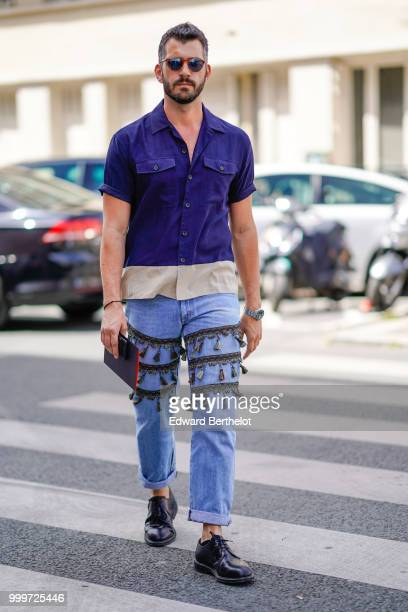 A guest wears a blue shirt blue jeans black leather shoes outside Wooyoungmi during Paris Fashion Week Menswear SpringSummer 2019 on June 23 2018 in...