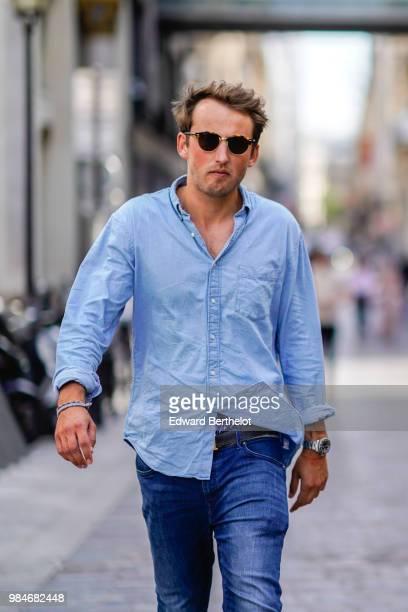 A guest wears a blue shirt outside Christian Dada during Paris Fashion Week Menswear SpringSummer 2019 on June 24 2018 in Paris France