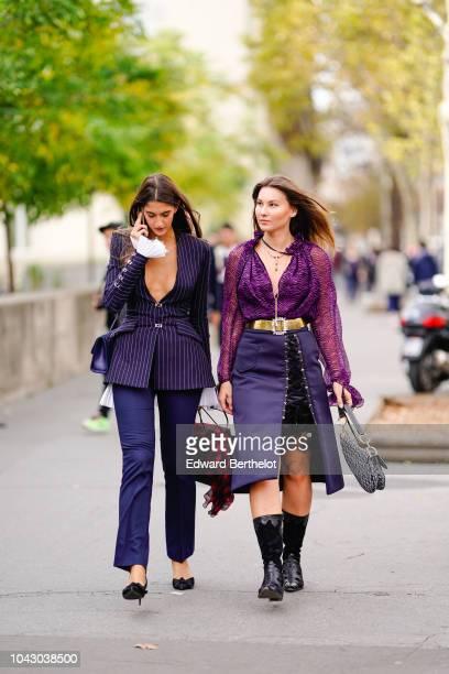 A guest wears a blue striped blazer jacket Angelica Ardasheva wears a purple mesh shirt a blue skirt outside Issey Miyake during Paris Fashion Week...