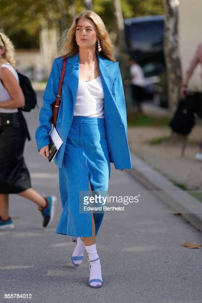 A guest wears a blue suit a white top blue skirt outside Nina Ricci during Paris Fashion Week Womenswear Spring/Summer 2018 on September 29 2017 in...
