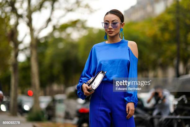 A guest wears a blue top blue flare pants sunglasses outside Andrew GN during Paris Fashion Week Womenswear Spring/Summer 2018 on September 29 2017...