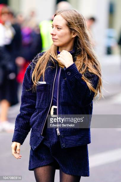 A guest wears a blue velvet jacket a blue skirt outside APC during Paris Fashion Week Womenswear Spring/Summer 2019 on October 1 2018 in Paris France