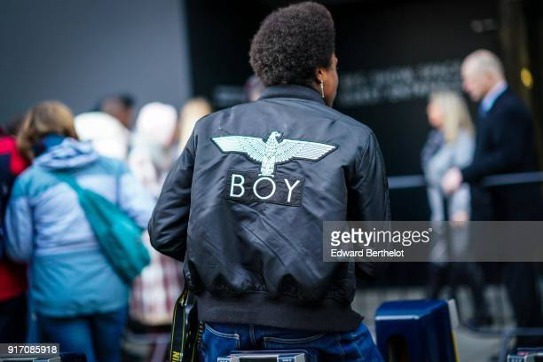 A guest wears a BOY black bomber jacket during London Fashion Week Men's January 2018 at on January 6 2018 in London England
