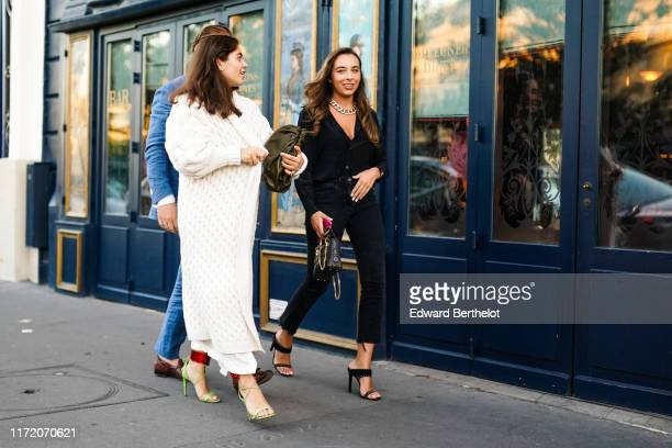 A guest wears a bronze color handbag a white knit long coat pistachiogreen heeled sandals with shiny red anklestraps A guest wears a chain necklace a...