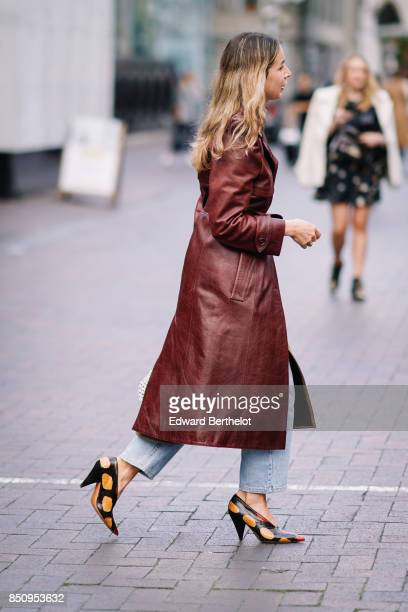 A guest wears a brown leather coat colored shoes outside Roland Mouret during London Fashion Week September 2017 on September 17 2017 in London...