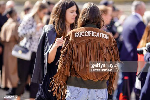 A guest wears a brown suede Gucci Guccification jacket with fringes outside Dior during Paris Fashion Week Womenswear Spring/Summer 2019 on September...