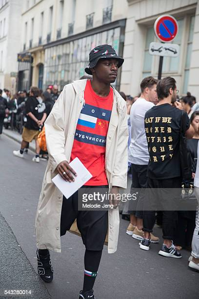 224a1f386 A guest wears a bucket hat and a Gosha Rubchinskiy tshirt at the Y3 show on