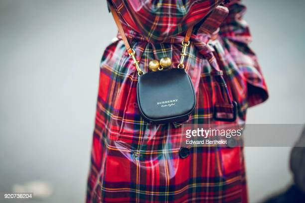 A guest wears a Burberry bag during London Fashion Week February 2018 on February 17 2018 in London England