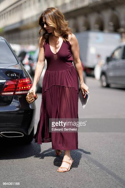 Guest wears a burgundy purple low neck pleated dress , outside Elie Saab, during Paris Fashion Week Haute Couture Fall Winter 2018/2019, on July 4,...