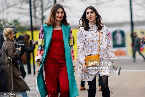 A guest wears a burgundy sweat shirt burgundy sport pants a turquoise blue coat with colorful sleeves colorful wristlets a white alligator pattern...