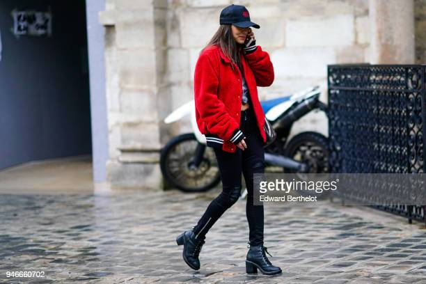 A guest wears a cap a redd jacket black pants black leather shoes outside Thom Browne during Paris Fashion Week Menswear Fall Winter 20182019 on...