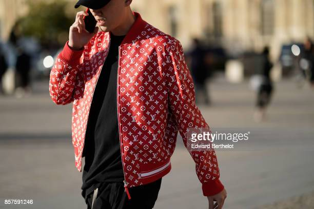 A guest wears a cap a Vuitton bomber red jacket outside Louis Vuitton during Paris Fashion Week Womenswear Spring/Summer 2018 on October 3 2017 in...