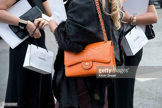 e235436c935b Guest wears a Chanel bag and Louis Vuitton scarf on day 8 during Paris  Fashion Week