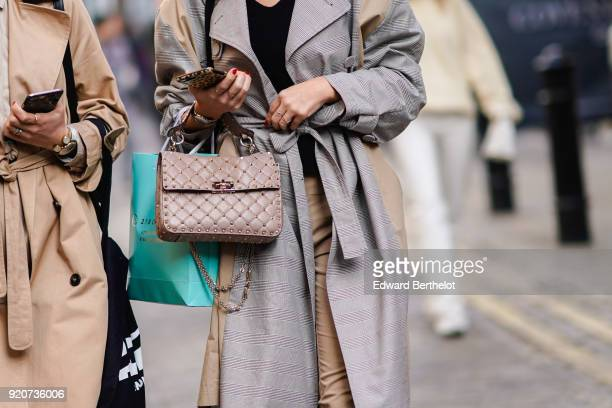 A guest wears a Chanel bag during London Fashion Week February 2018 on February 17 2018 in London England