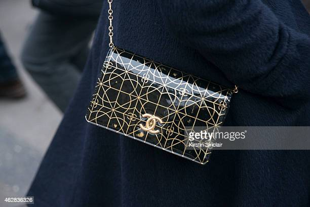 A guest wears a Chanel bag on day 3 of Paris Haute Couture Fashion Week Spring/Summer 2015 on January 27 2015 in Paris France