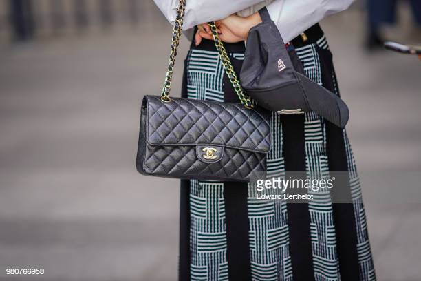 A guest wears a Chanel bag outside Issey Miyake during Paris Fashion Week Menswear SpringSummer 2019 on June 21 2018 in Paris France