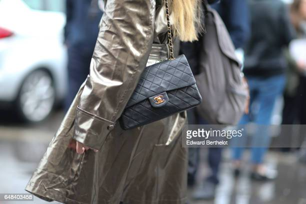 A guest wears a Chanel bag outside the Elie Saab show during Paris Fashion Week Womenswear Fall/Winter 2017/2018 on March 4 2017 in Paris France