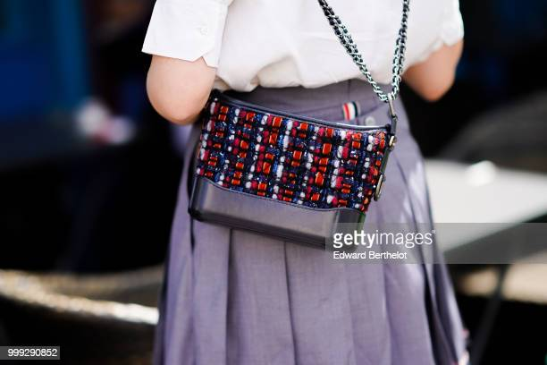A guest wears a Chanel bag outside Wooyoungmi during Paris Fashion Week Menswear SpringSummer 2019 on June 23 2018 in Paris France