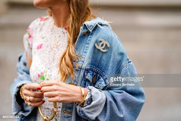 A guest wears a Chanel brooch outside Manish Arora during Paris Fashion Week Womenswear Spring/Summer 2018 on September 28 2017 in Paris France