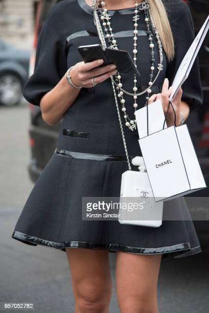 A guest wears a Chanel dress bag and necklaces on day 3 of Paris Haute Couture Fashion Week Autumn/Winter 2016 on July 5 2016 in Paris France