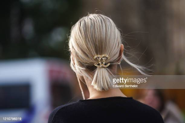 Guest wears a Chanel hair pin, outside Chanel, during Paris Fashion Week - Womenswear Fall/Winter 2020/2021 on March 03, 2020 in Paris, France.