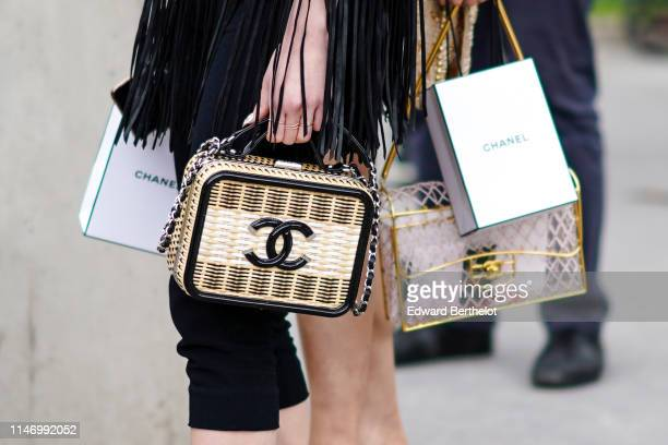 Guest wears a Chanel vanity bag, outside the Chanel Cruise Collection 2020 At Grand Palais on May 03, 2019 in Paris, France.