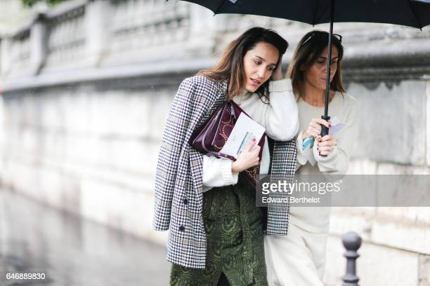 A guest wears a checked blazer jacket a bag and a green skirt outside the Lanvin show during Paris Fashion Week Womenswear Fall/Winter 2017/2018 on...