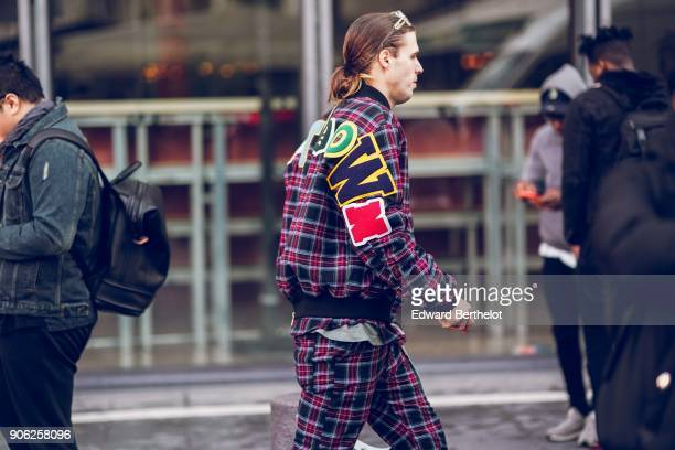 A guest wears a checked coat outside Off White during Paris Fashion Week Menswear Fall Winter 20182019 on January 17 2018 in Paris France