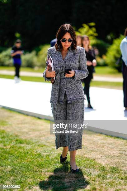 A guest wears a checked pattern gray blazer jacket cropped pants outside Dior during Paris Fashion Week Haute Couture Fall Winter 2018/2019 on July 2...