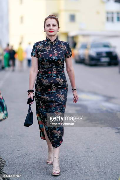A guest wears a chinese dress with embroidered flowers during Feeric Fashion Week 2018 on July 20 2018 in Sibiu Romania