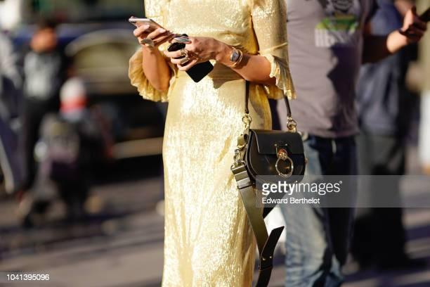 A guest wears a Chloe bag outside Rochas during Paris Fashion Week Womenswear Spring/Summer 2019 on September 26 2018 in Paris France