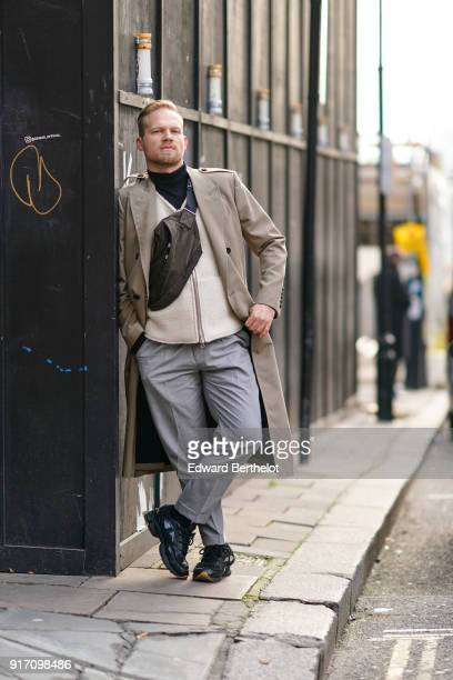A guest wears a coat gray pants during London Fashion Week Men's January 2018 at on January 6 2018 in London England