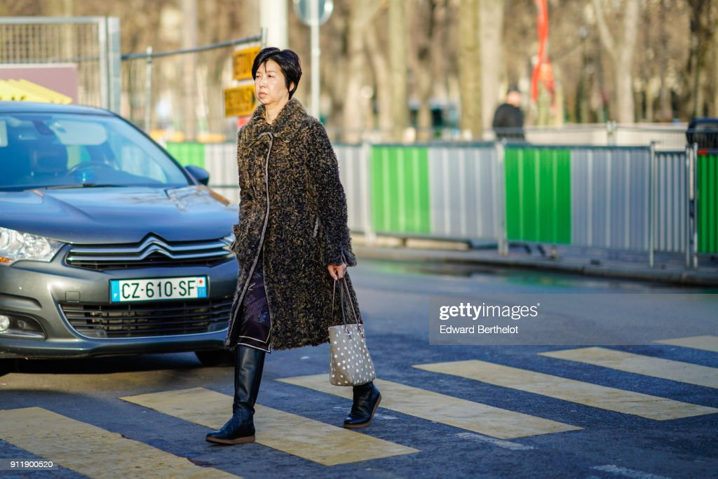 A guest wears a coat, outside Chanel, during Paris Fashion Week -Haute Couture Spring/Summer 2018, on January 23, 2018 in Paris, France.