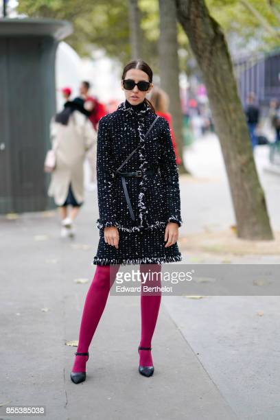 A guest wears a coat pink tights outside Carven during Paris Fashion Week Womenswear Spring/Summer 2018 on September 28 2017 in Paris France