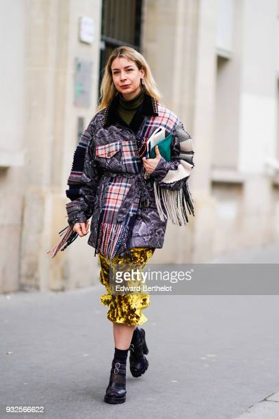 A guest wears a coat with checked tartan fabric and fringes a yellow skirt black shoes during Paris Fashion Week Womenswear Fall/Winter 2018/2019 on...