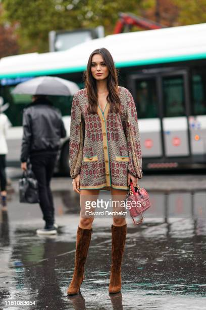 Guest wears a colorful lamed cardigan, a red Chanel bag, brown suede knee-high boots, outside Chanel, during Paris Fashion Week - Womenswear Spring...