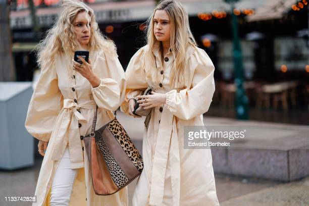 A guest wears a cream color long dress with puff sleeves a tote bag a guest wears a cream color long dress with puff sleeves a beige quilted bag...