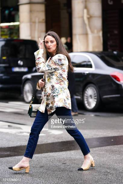 A guest wears a creamcolor jacket with colorful floral prints navyblue crop jeans Chanel beige and black slingback pumps a Louis Vuitton quilted bag...