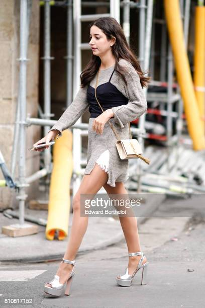 A guest wears a dress silver shoes and a YSL bag outside the Schiaparelli show during Paris Fashion Week Haute Couture Fall/Winter 20172018 on July 3...