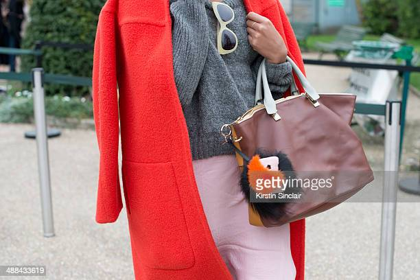 A guest wears a Fendi Monster on day 6 of Paris Collections Women on March 02 2014 in Paris France