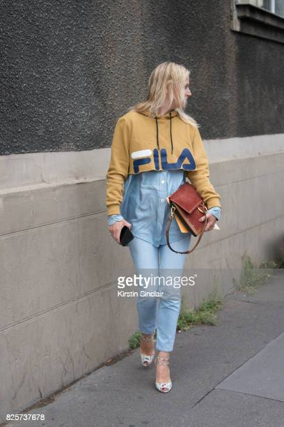 A guest wears a Fila sweater and Chloe bag day 1 of Paris Haute Couture Fashion Week Autumn/Winter 2017 on July 2 2017 in Paris France