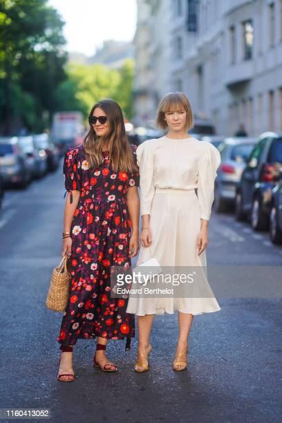 A guest wears a floral print dress a basket bag Vika Gazinskaya wears a wihite dress a white bag outside Valentino during Paris Fashion Week Haute...