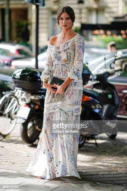 A guest wears a flower print dress and a Chanel bag outside the Zuhair Murad show during Paris Fashion Week Haute Couture Fall/Winter 20172018 on...
