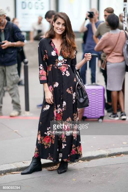 A guest wears a flower print dress outside Andrew GN during Paris Fashion Week Womenswear Spring/Summer 2018 on September 29 2017 in Paris France