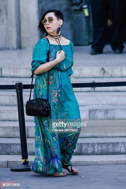 A guest wears a flower print dress outside the 22/4 Hommes show during Paris Fashion Week Menswear Spring/Summer 2018 on June 23 2017 in Paris France