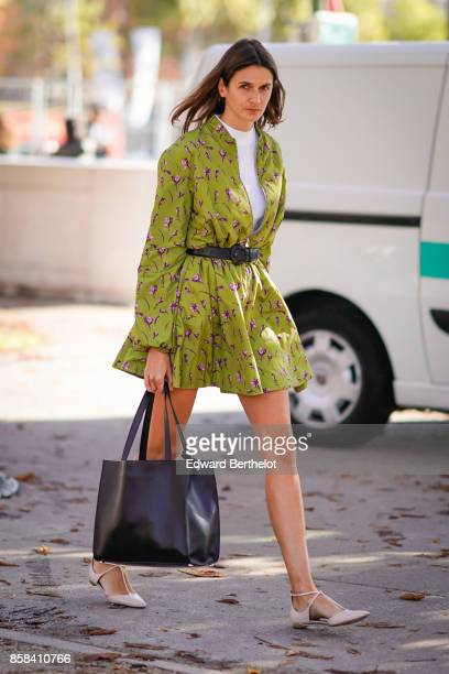 A guest wears a flower print green dress outside Chanel during Paris Fashion Week Womenswear Spring/Summer 2018 on October 3 2017 in Paris France